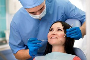 woman getting cleaning from a dentist Orlando trusts
