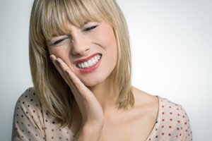 woman suffering knows how tooth cavities lead to tooth decay
